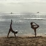 on the beach doing yoga things
